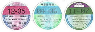 Motor tax in the Republic of Ireland - Motor tax discs for various private vehicles, 2005 to 2007. One of these is required by law to be displayed on a vehicle to show current tax has been paid. The large printed numbers indicate the date of expiry (Month-Year).