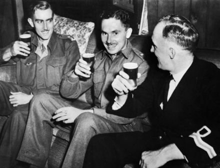 Ivan Lyon (centre) celebrating with two other members of Z Force following the success of Operation Jaywick - Japanese occupation of Singapore