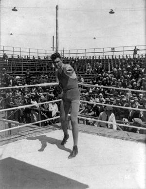 English: American boxer Jack Dempsey posing in...