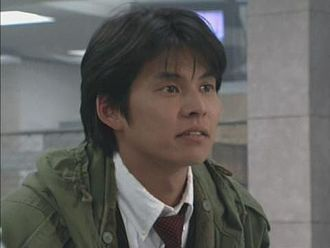 FEU Institute of Technology - Image: Japanese man wearing a green coat and red tie