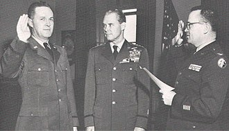 Commander of the Air Force Office of Special Investigations - Brig. Gen. Joseph F. Carroll (left) being sworn in as AFOSI's first Commander, as Chief of Staff of the Air Force Hoyt S. Vandenberg (center) witnesses the swearing-in, ca. 1948.