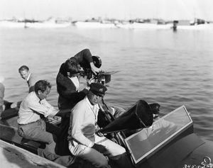 King Vidor - King Vidor and his cameramen set out in his Hacker-Craft speedboat to film water sequences for his 1928 MGM picture, The Patsy.