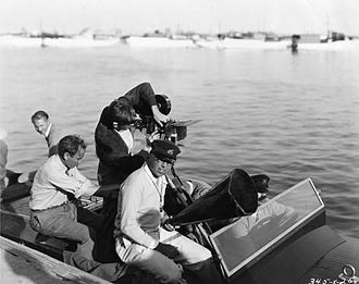 King Vidor - King Vidor, with megaphone, and crew on a Hacker-Craft speedboat to film water sequences for his 1928 MGM picture, The Patsy.