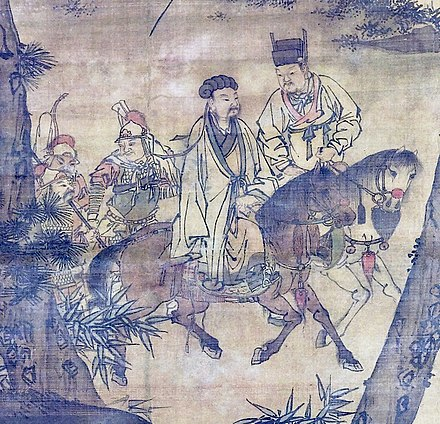 The painting Kongming Leaving the Mountains (detail, Ming dynasty), depicting Zhuge Liang (left, on a horse) leaving his rustic retreat to enter into the service of Liu Bei (right, on a horse) Kongming Leaving the Mountains (cropped).jpg