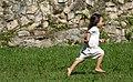 Lacandon little girl running in the grass at Bonampak.jpg