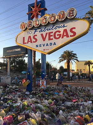 2017 Las Vegas shooting - The Las Vegas sign adorned with flowers on October 9, 2017, a week after the shooting