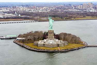 Liberty Island is an exclave of Manhattan, of New York City, and of New York State, that is surrounded by New Jersey waters Liberty Island photo D Ramey Logan.jpg