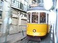 Lisbon tram speeding in Alfama.jpg