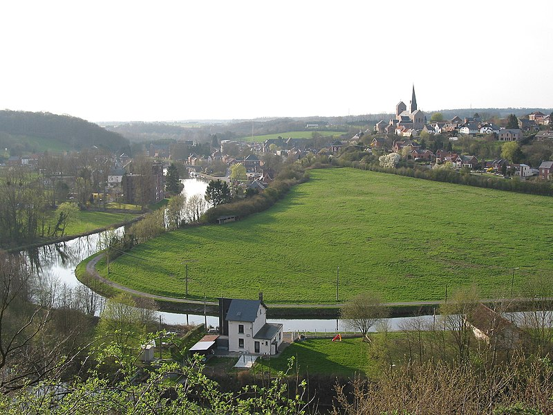 Lobbes (Belgium), the Sambre river, the old town and the Saint Ursmar Collegiate church (IXth century).
