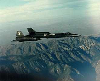 Lockheed YF-12 - YF-12A overflying a mountain.