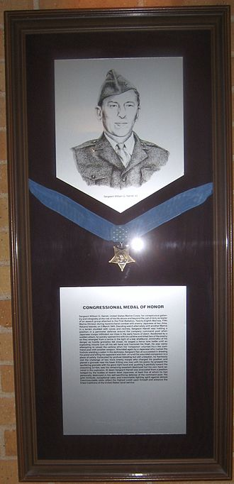 William G. Harrell - William G. Harrell and a specimen Medal of Honor on display at Texas A&M University