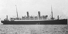 A black-and-white photograph of a luxury ocean liner.