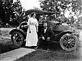 Man and woman with automobile, ca 1908 (TRANSPORT 80).jpg