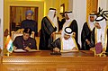 Manmohan Singh and the Prime Minister and Foreign Minister of Qatar, Sheikh Hamad bin Jassem bin Jabor al Thani witnessing the signing of an agreement on Law Enforcement Matters between the India and Qatar, in Doha, Oatar .jpg