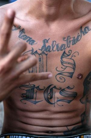 MS-13 - An MS gang sign and tattoos