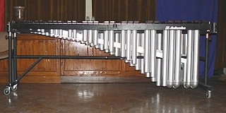 Marimba percussion instrument consisting of a set of wooden bars struck with mallets