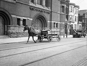 History of the Jews in Toronto - Horse-drawn wagon in front of Beth Hamidrash Hagadol-McCaul Street Synagogue