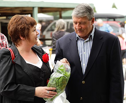 Anderton with Megan Woods (left), November 2010 Megan and Jim with Marty at the Riccarton Market.jpg