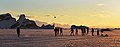 Members of HMS Protectors Ships Company, play football on the ice as the sun sets in Antarctica. MOD 45156396.jpg