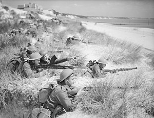 50th (Northumbrian) Infantry Division - Men of the 7th Battalion, Green Howards among the sand dunes at Sandbanks, near Poole, Dorset, 31 July 1940.