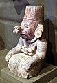 Mesoamerica, oaxaca, zapotechi, urna a forma di figura inginocchiata con maschera nasale, 300 ac-700 dc ca. 02 zanne.jpg