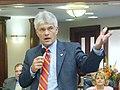 Michael Grant cgestures as he debates a measure on the House floor.jpg