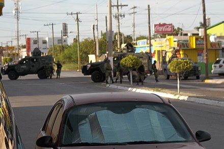 Mexican soldiers raid a house reportedly owned by the Gulf Cartel in 2012. Militaresmexicanos-Matamoros.JPG