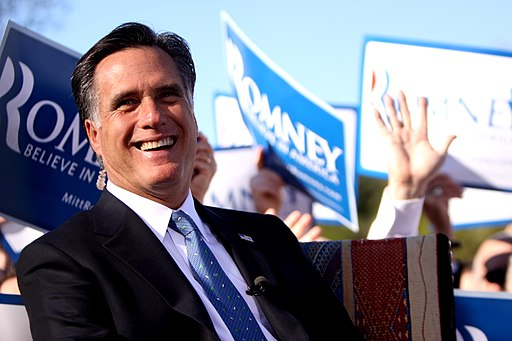 Mitt Romney laughing at rally