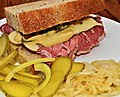 Mmm... Corned beef and Swiss on deli rye with Dijon and dill pickles (6256959853).jpg