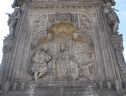Monument to Columbus, Statue commemorating New World discoveries. Western facade of monument. Isabella at the center, Columbus on the left, a cross on her right. Plaza de Colon, Madrid (1881-85) Monumento a Colon (Madrid) 02c.jpg