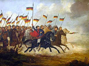 Ragamuffin War - Charge of the Cavalry by Guilherme Litran (Júlio de Castilhos Museum, Porto Alegre), depicting the Riograndense army. The flag appears to be similar to the German flag, but the top color is a dark green.