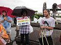 NOLA BP Oil Flood Protest brollys Drill Spill Kill.JPG