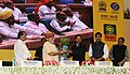 """Narendra Modi being presented a """"Plant"""" as symbol of farming, at the launching ceremony of DD Kisan Channel, in New Delhi. The Union Minister for Agriculture, Shri Radha Mohan Singh.jpg"""