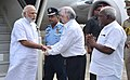 Narendra Modi being received by the Governor of Kerala, Justice (Retd.) P. Sathasivam and the Minister of State for Road Transport & Highways and Shipping, Shri P. Radhakrishnan on his arrival.jpg