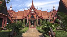 A building in traditional Cambodian style, in front of which is a path and garden.