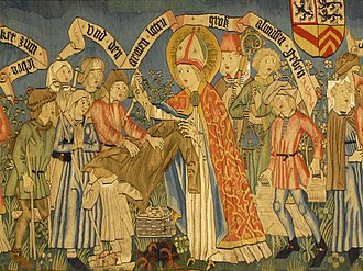 St Adelphus gives clothes to the poor, part of the tapestry of the Life and Miracles of St Adelphus, c. 1510 (Eglise Saint-Pierre-et-Saint-Paul, Neuwiller-les-Saverne) Neuwiller StPierre-Paul 237.JPG