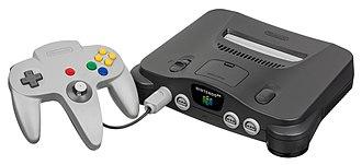 Nintendo 64 - A charcoal grey Nintendo 64 console and grey controller