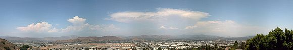Thunderstorms during the North American Monsoon as seen from El Cajon, California. The thunderstorms rarely push beyond the Peninsular Ranges to the clear skies of the coastal strip.