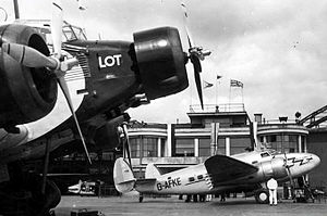 Warsaw Chopin Airport - The first British Airways flight from Warsaw to London waits alongside a LOT Junkers Ju 52 at Okęcie in April 1939