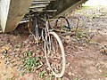 Old bicycle with sidecar, abandonned under stairs in Singapore.jpg