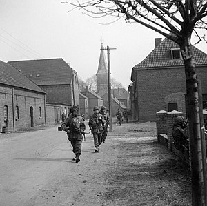 8th (Midlands) Parachute Battalion - Paratroopers advance through a German town.