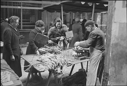 potatoes and leeks on sale in a paris market there was little else to buy spring 1945 imperial war museums u k