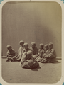 Pastimes of Central Asians. Two Boys Wrestling in Front of a Group WDL10814.png