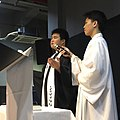 Pastor William Leong and the alter server.jpg