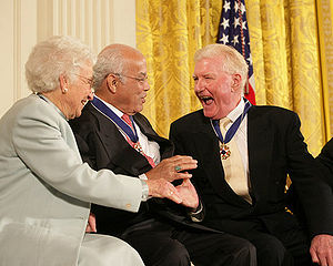 Paul Johnson (writer) - Paul Johnson (right) is congratulated by Norman Francis and Ruth Johnson Colvin after receiving his Presidential Medal of Freedom from President George W. Bush, 15 December 2006