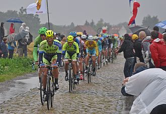 2014 Tour de France - Stage five, between Ypres, Belgium, and Arenberg Porte du Hainaut, featured sett paving sections used in the one-day race Paris–Roubaix.