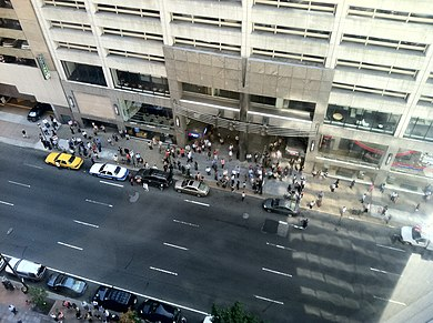 Building occupants evacuate onto Market Street in Philadelphia. Image: Douglas Muth.