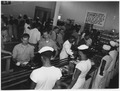 "Photograph with caption ""Cafeteria Lines in Mess Hall at Naval Barracks Area,"" U.S. Naval Ammunition Depot, Hastings... - NARA - 283487.tif"