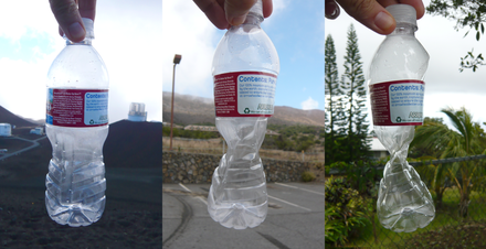 This plastic bottle was sealed at approximately 14,000 feet (4,300 m) altitude, and was crushed by the increase in atmospheric pressure, recorded at 9,000 feet (2,700 m) and 1,000 feet (300 m), as it was brought down towards sea level. Plastic bottle at 14000 feet, 9000 feet and 1000 feet, sealed at 14000 feet.png