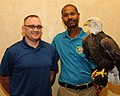 Posing for picture with Bald Eagle. (10595017843).jpg
